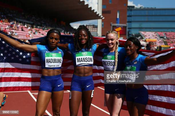 Symone Mason Shae Anderson Julia Madubuike and Taylor Manson of The USA celebrate winning gold in the final of the women's 4x400m relay on day six of...