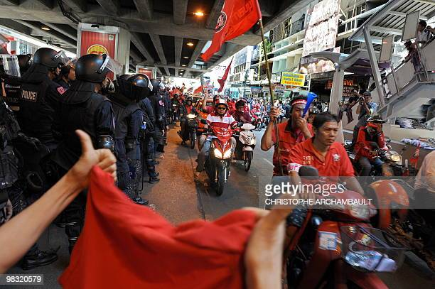 A sympathiser shows thumbs up as antigovernment protesters parade through the financial district during a rally in central Bangkok on April 6 2010...