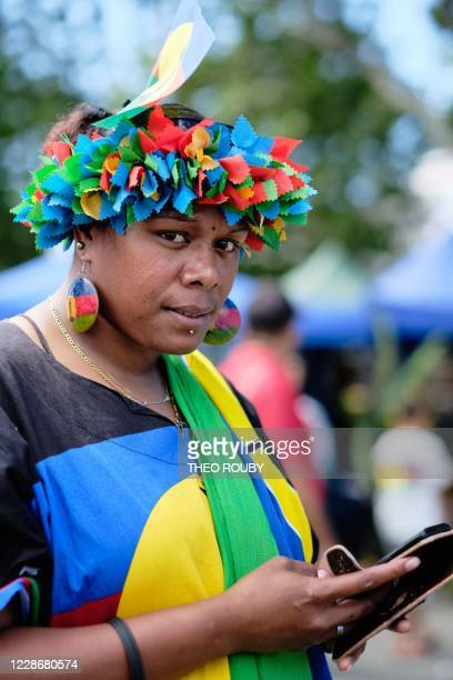 A sympathizer of the Kanak independence movement looks on during a symbolic day marking the taking of possession of New Caledonia by France on...