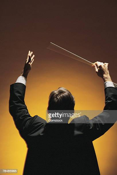 Symphony conductor conducting