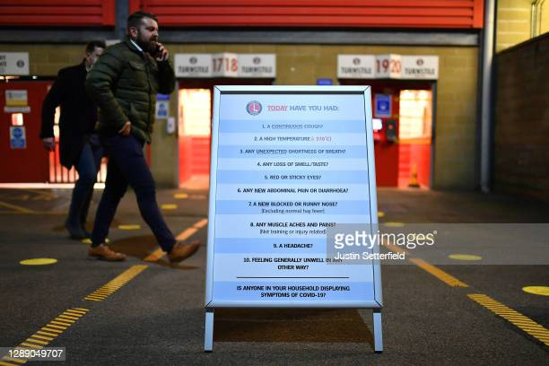 Symptom check questionnaire is seen outside the stadium prior to the Sky Bet League One match between Charlton Athletic and Milton Keynes Dons at The...