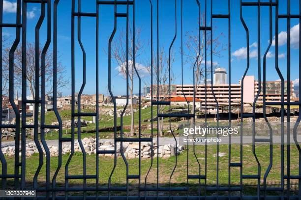 symrna ancient city behind iron fence bars. - emreturanphoto stock pictures, royalty-free photos & images