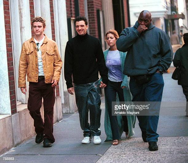 N'sync band members Justin Timberlake left JC Chasez center and Chasez's girlfriend right stroll down Madison Avenue October 24 2000 before heading...