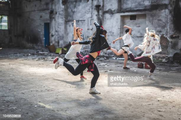 Synchrinized female break dancers exercise together