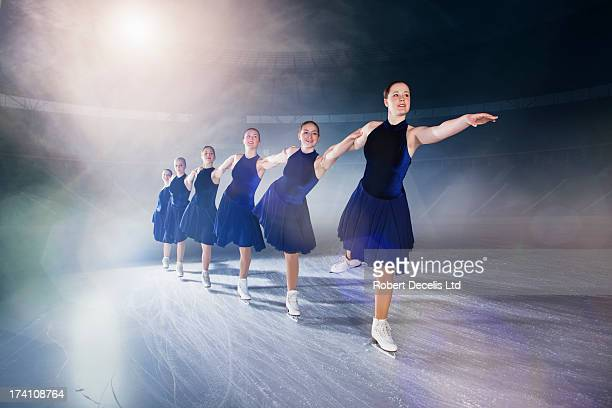 synchro skate team performing routine. - ice skating stock pictures, royalty-free photos & images