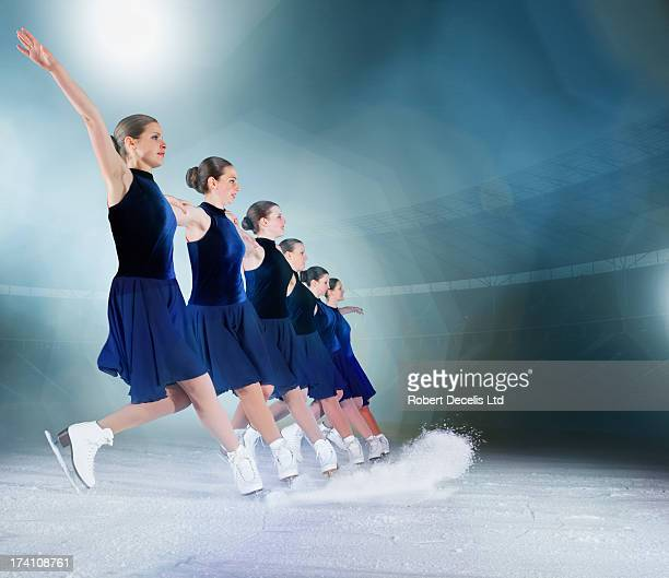 synchro team stopping in line with ice spray. - ice skating stock pictures, royalty-free photos & images