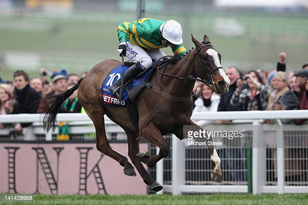Synchronised ridden by Tony McCoy on his way to winning the Cheltenham Gold Cup Steeplechase race at Cheltenham Racecourse on March 16, 2012 in...
