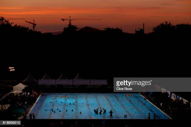 Synchronised swim teams practice after sunset on day six of the Budapest 2017 FINA World Championships on July 19 2017 in Budapest Hungary