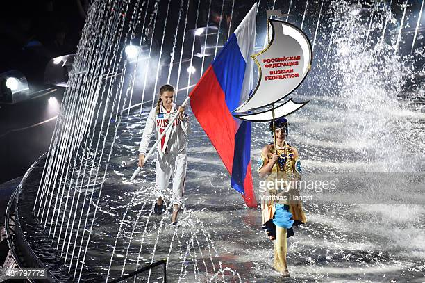 Synchronised swimmer Natalia Ishchenko of Russia carries the national flag during the Opening Ceremony of the 16th FINA World Championships at...