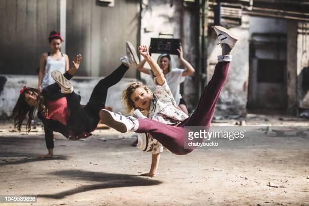Synchronized break dancers dancing together
