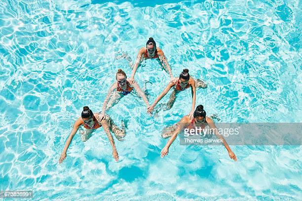 Synchronized swim team in pyramid shape