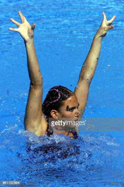 Synchronized swimmer Olga Larissa completes her routine in San Salvador EL Salvador 05 December 2002 Olga Larissa de Mexico participa el 05 de...