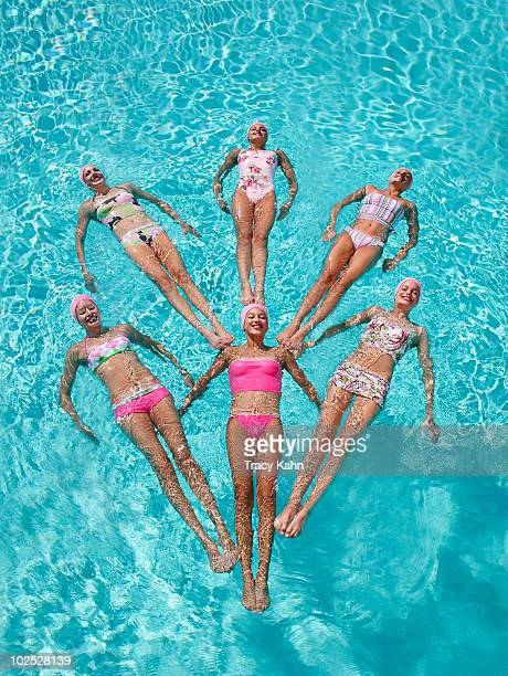 Synchronized swimmers floating in formation