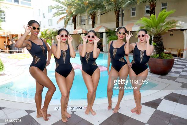 Synchronized swimmers perform during the IIzipizi X Sunny Life Pool Party Music By Odalys And Special Performance By Aqualillies Paraiso Miami Beach...