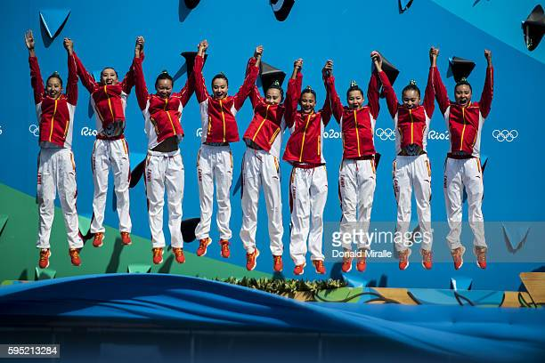 2016 Summer Olympics Team China victorious jumping on the podium with Silver medals after the Women's Team Free Routine Final at Maria Lenk Aquatics...