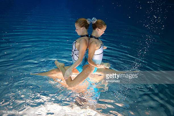 synchronized swimming team - artistic swimming stock pictures, royalty-free photos & images