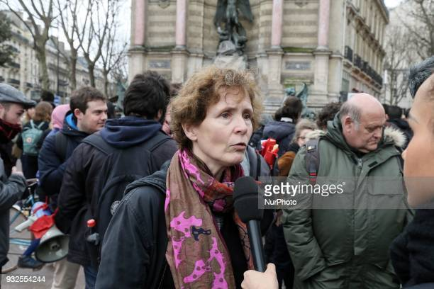 Syndicat National des Enseignements du Second Degre FSU union spokesperson Frederique Rolet answer to journalit as she takes part in a rally to...