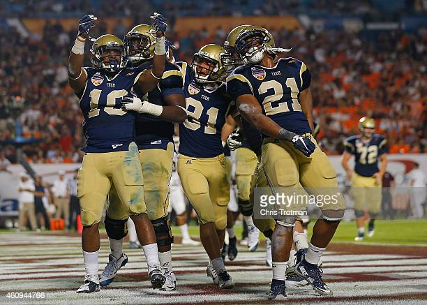 Synjyn Days of the Georgia Tech Yellow Jackets reacts after scoring a touchdown during the second half of the Capital One Orange Bowl game against...