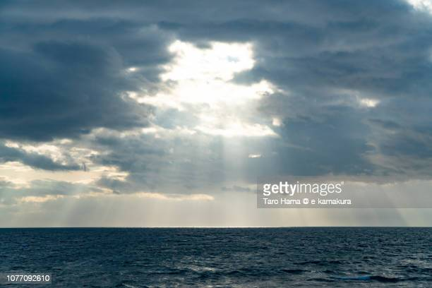 synmetric sunbeam on sagami bay, part of pacific ocean in japan - 雲海 ストックフォトと画像