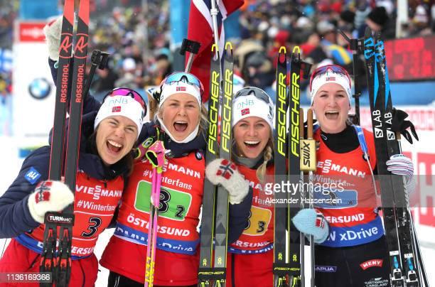 Synnoeve Solemdal Ingrid Landmark Tandrevold Tiril Eckhoff and Marte Olsbu Roeiseland of Norway celebrate after winning gold during the Women's 4x6km...