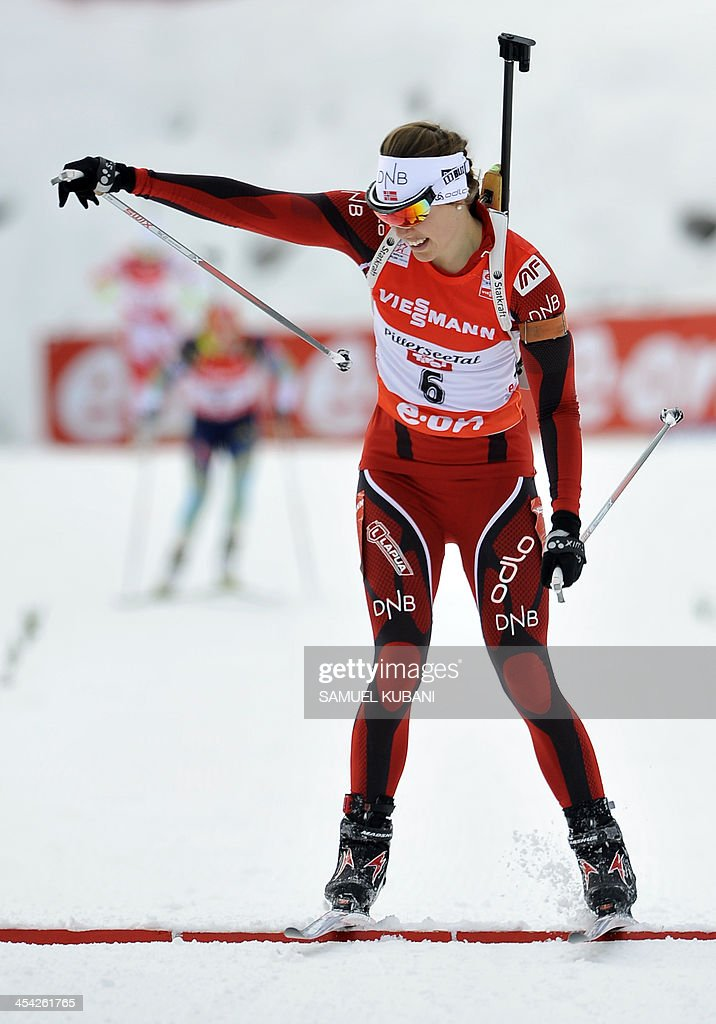Synnoeve Solemdal of Norway crosses the finish line of the women's10km pursuit competition of the IBU Biathlon World Cup in Hochfilzen, Austria, on December 8,2013.