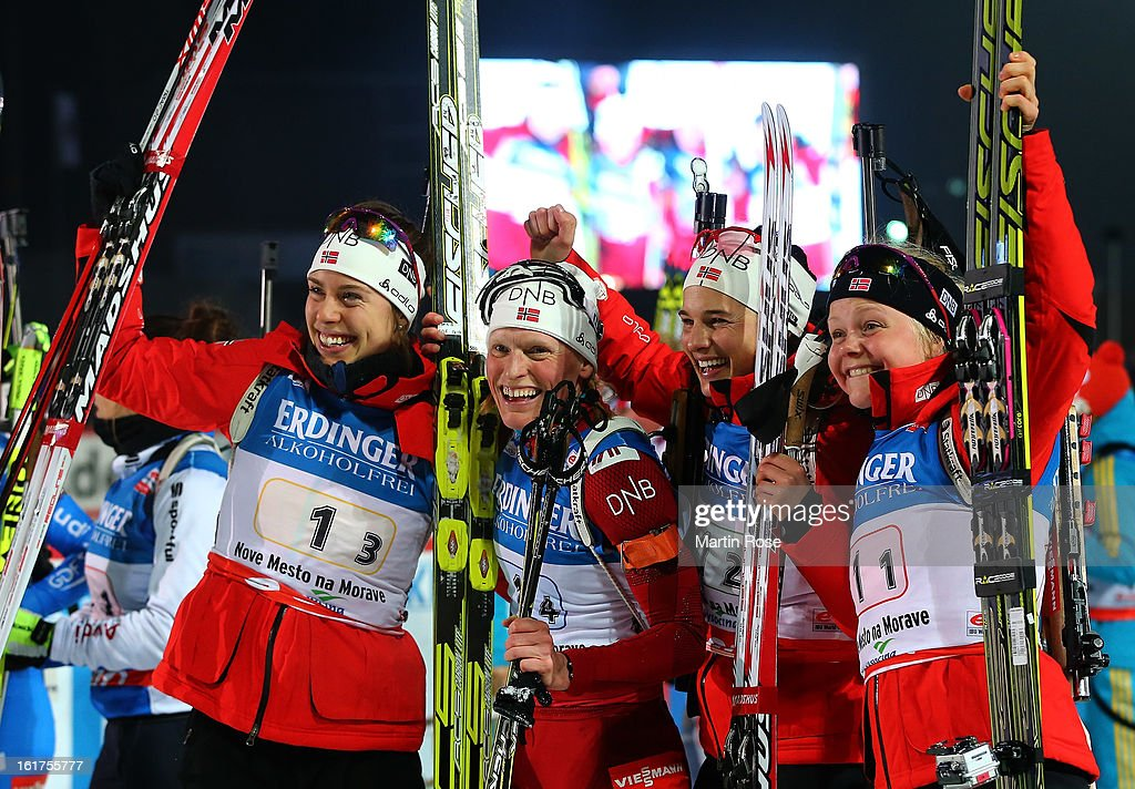 Synnoeve Solemdal, Tora Berger, Ann Kristin Flatland and Hilde Fenne of Norway celebrate after winning the gold medal in the Women's 4 x 6km Relay in the IBU Biathlon World Championships at Vysocina Arena on February 15, 2013 in Nove Mesto na Morave, Czech Republic.