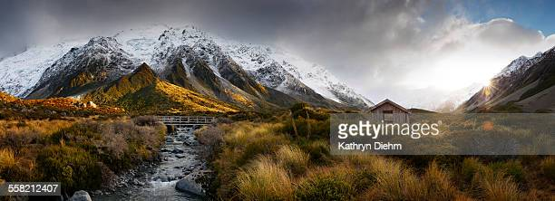 synshine on snow covered mountains, creek & bridge - weather stock pictures, royalty-free photos & images