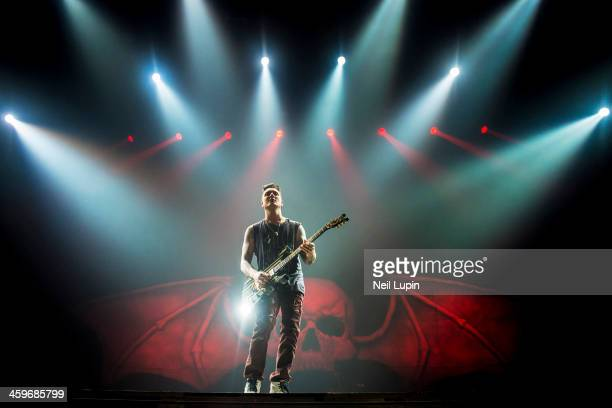 Synster Gates of Avenged Sevenfold performs on stage at Wembley Arena on December 1 2013 in London United Kingdom