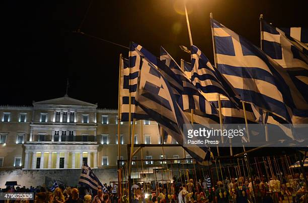 Syntagma square is full of demonstrators Greek people celebrate after hearing that the majority of the voters voted NO in the referendum and asked...