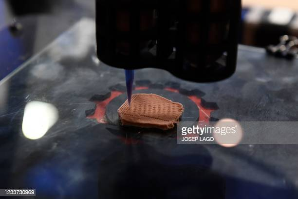 Synthetic 3D-printer prints plant-based proteins that can mimic the texture of beef at the Mobile World Congress fair in Barcelona on June 30, 2021.