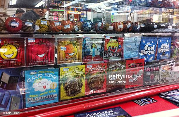 Synthetic marijuana, sold in colorful packages with names like Cloud Nine, Maui Wowie and Mr. Nice Guy, sits behind the glass counter at a Kwik Stop...