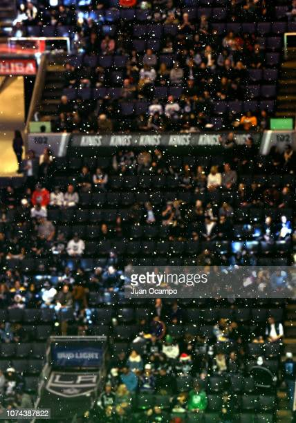 Synthetic snow falls as part of inarena entertainment during an intermission of the game between the Winnipeg Jets and the Los Angeles Kings at...