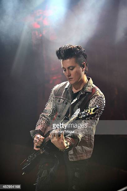 Synyster Gates of Avenged Sevenfold performs onstage during Rockstar Energy Mayhem Festival at Nikon at Jones Beach Theater on July 30 2014 in...