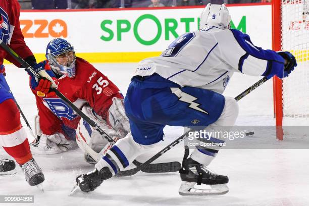 Syracuse Crunch center Anthony Cirelli shoots the puck behind Laval Rocket goalie Charlie Lindgren and scores making the score 21 Crunch during the...