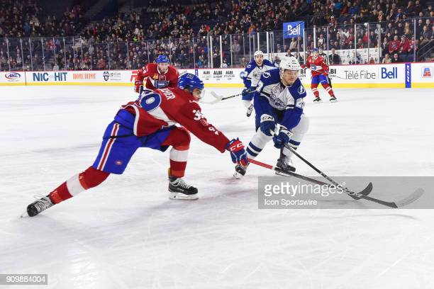 Syracuse Crunch defenceman Dominik Masin tries to stop Laval Rocket left wing Jordan Boucher by stretching his stick out during the Syracuse Crunch...