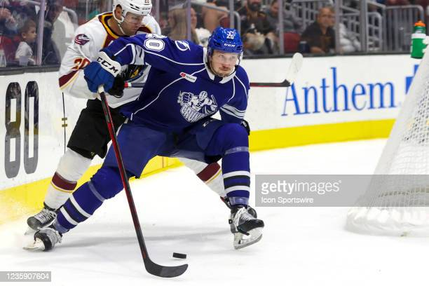 Syracuse Crunch defenceman Ryan Jones plays the puck during the third period of the American Hockey League game between the Syracuse Crunch and...