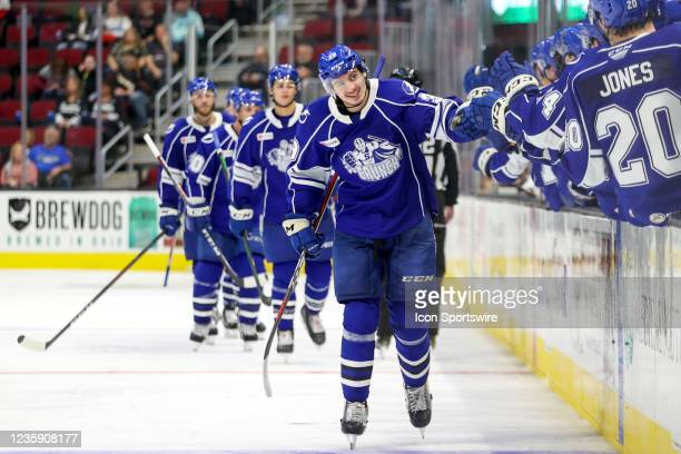 Syracuse Crunch forward Gage Goncalves is congratulated by teammatres after scoring a goal during the third period of the American Hockey League game...