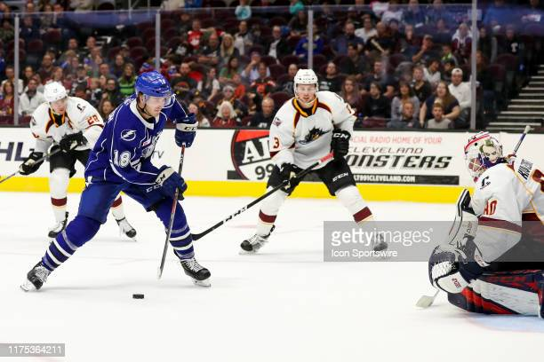 Syracuse Crunch right wing Taylor Raddysh looks to shoot against Cleveland Monsters goalie Matiss Kivlenieks during the third period of the American...