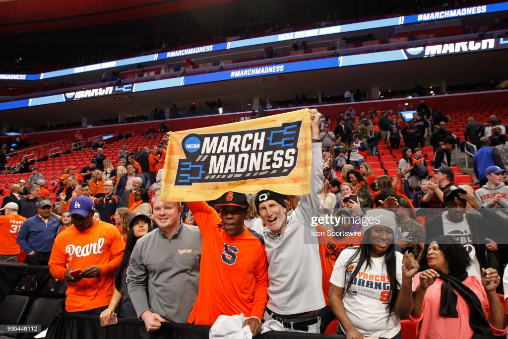 Syracuse Fans Hold Up A March Madness Towel At The