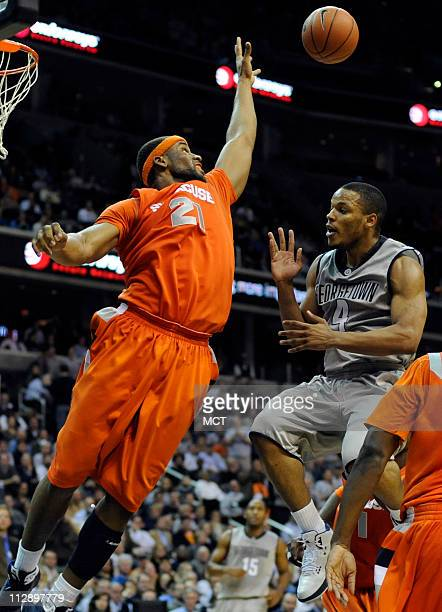 Syracuse forward Arinze Onuaku defends on a soft floater in the lane by Georgetown guard Chris Wright late in the second half at the Verizon Center...