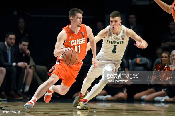 Syracuse guard Joseph Girard III attempts to drive to the basket around Miami guard Dejan Vasiljevic in the second half as the University of Miami...