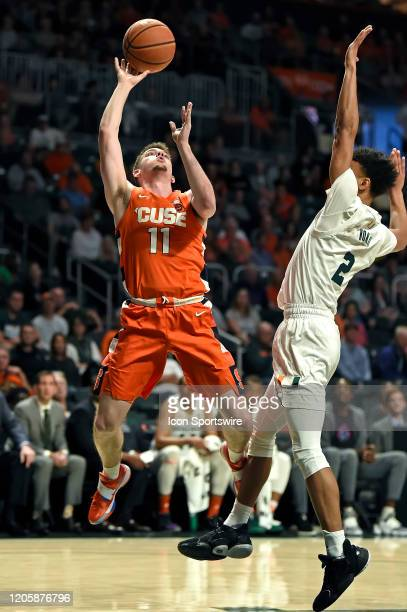 Syracuse guard Joseph Girard III attempts to put up a basket over Miami guard Isaiah Wong in the first half as the University of Miami Hurricanes...