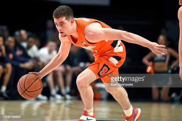 Syracuse guard Joseph Girard III handles the ball in the first half as the University of Miami Hurricanes faced the Syracuse University Orangemen on...
