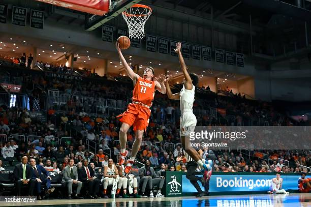 Syracuse guard Joseph Girard III puts up a basket despite the efforts of Miami guard Kameron McGusty in the first half as the University of Miami...