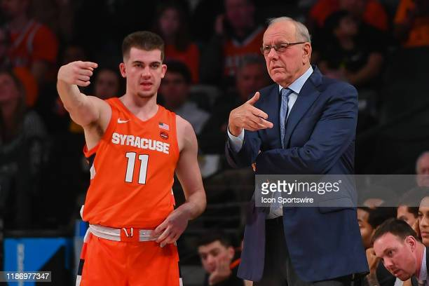 Syracuse head coach Jim Boeheim talks with point guard Joseph Girard III during the NCAA basketball game between the Syracuse Orange and the Georgia...