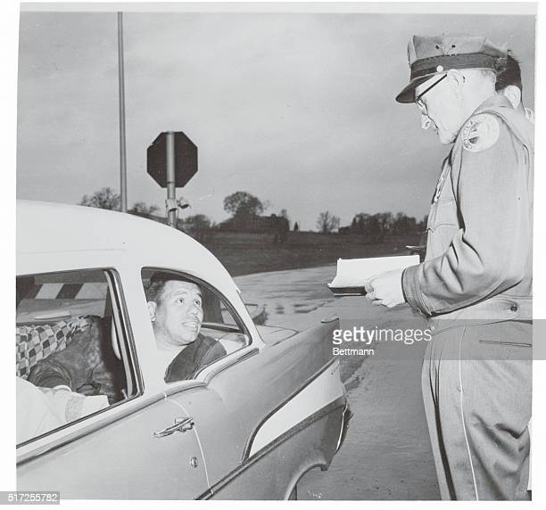 Syracuse, New York: According To The Book. Toll collector Edwin Dwyer studies a volume of New York State Law at his post on the New York State...