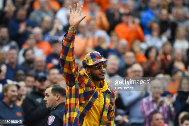 Syracuse Orange basketball alum Carmelo Anthony waves to the crowd prior to the game against the Virginia Cavaliers at the Carrier Dome on November 6...