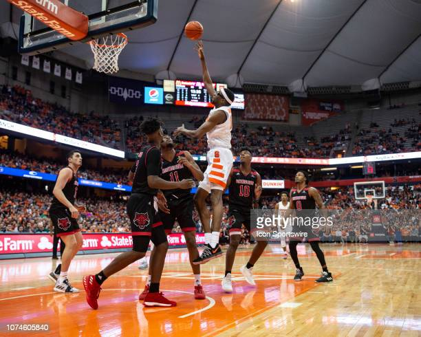 Syracuse Orange Center Paschal Chukwu shoots a hook shot over Arkansas State Red Wolves Forward JJ Matthews and Arkansas State Red Wolves Forward...