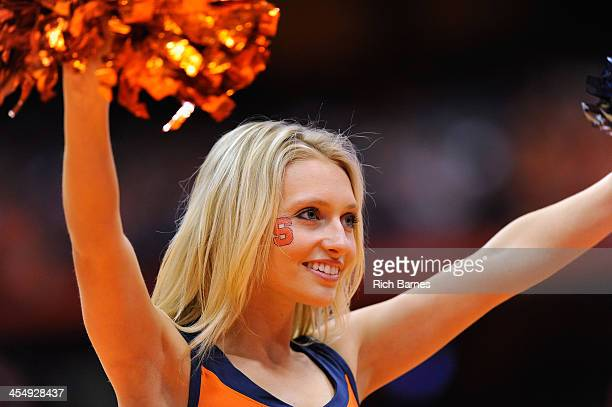 Syracuse Orange cheerleader performs against the Indiana Hoosiers during the second half at the Carrier Dome on December 3 2013 in Syracuse New York...