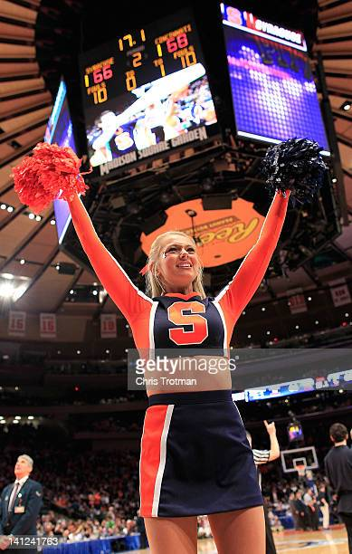 Syracuse Orange cheerleader performs during a timeout against the Louisville Cardinals during the semifinals of the Big East men's basketball...